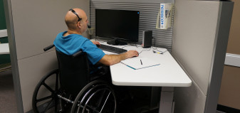Worker in wheelchair at desk