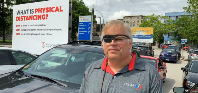 David Black poses in front of Royal Columbian Hospital in New Westminster, B.C.